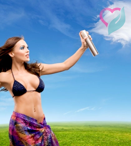 women spraying air freshner