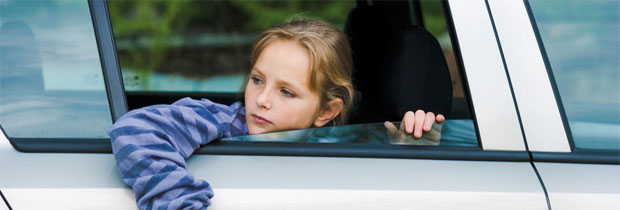 girl looking through car window