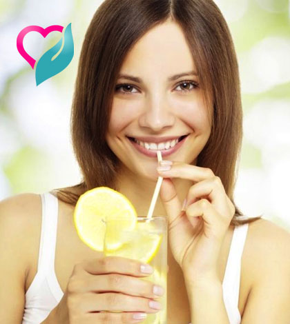 woman drinking lemon water