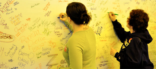 signing on wall