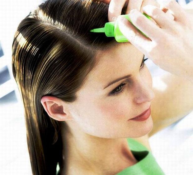applying hair oil