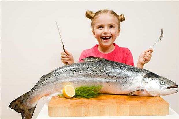 kid eating big fish