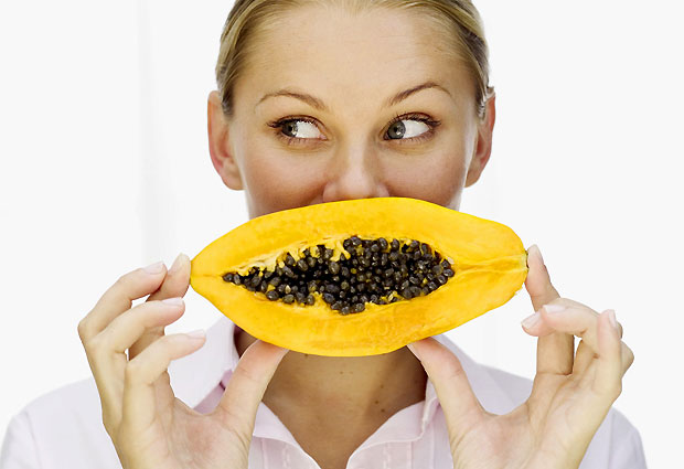 woman eating papaya