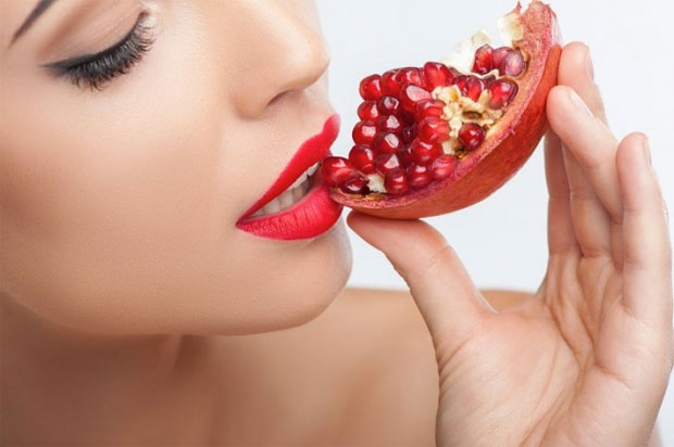 eating pomegranate