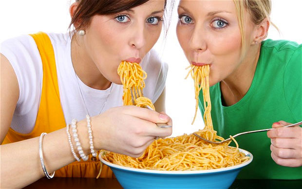 girls eating pasta