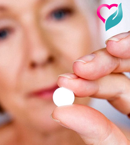 calcium tablet in women's hand