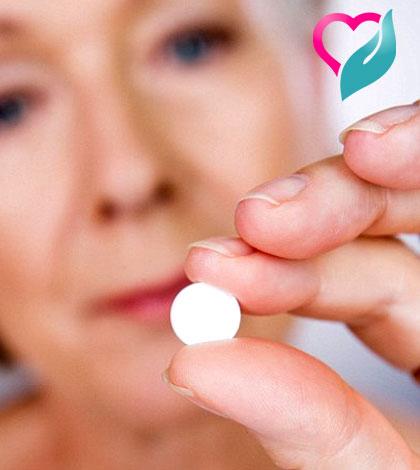 calcium tablet in women's hand