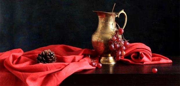 copper pot and grapes