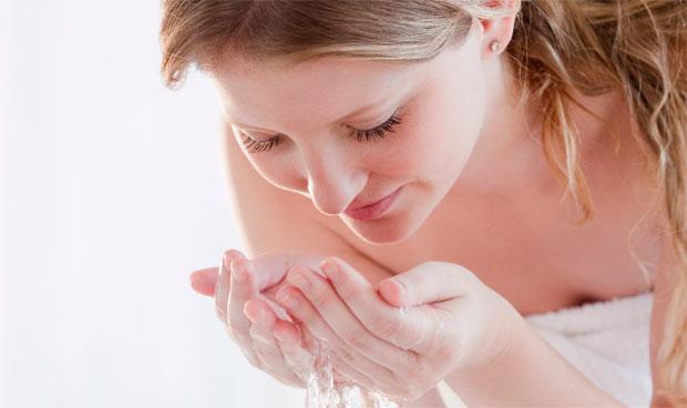 woman eye water splash