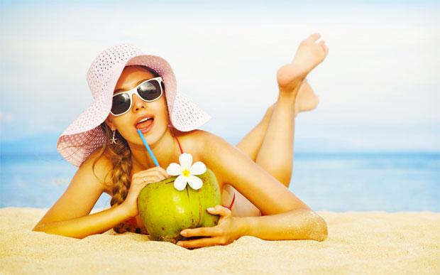 coconut drinking women on beach