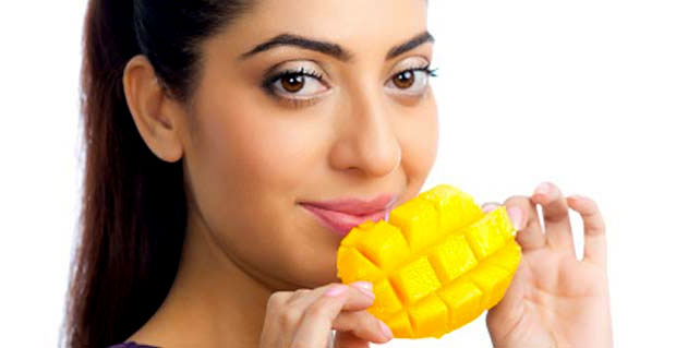 woman eating mango