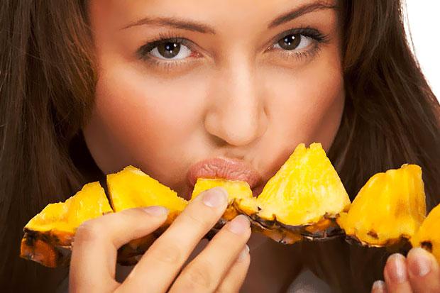 eating pineapple