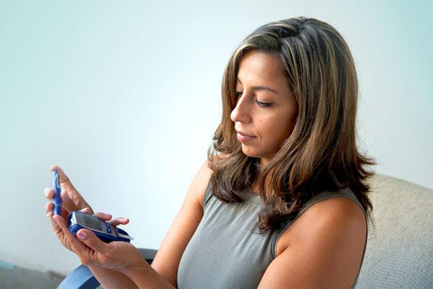 diabetes checking woman
