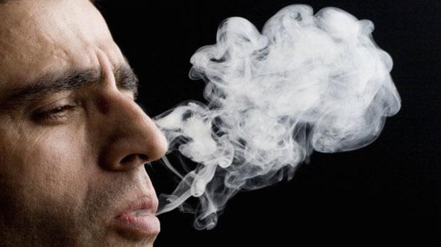 smoking bald man