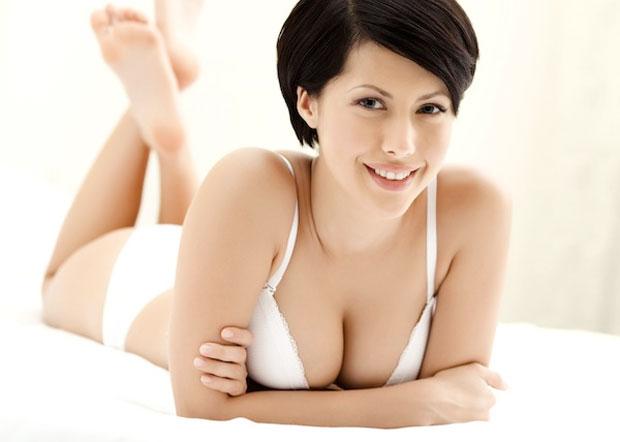 girl wearing bra in bed