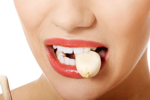 girl biting garlic